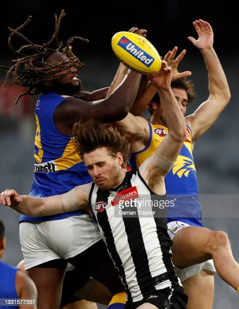 Nic Naitanui of the Eagles attempts to mark the ball over Jordan Roughead of the Magpies during the round 20 AFL match between Collingwood Magpies...