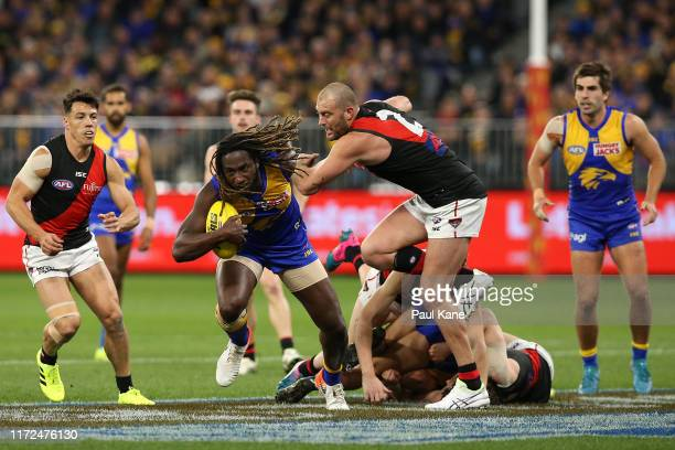 Nic Naitanui of the Eagles breaks clear with the ball against Tom Bellchambers of the Bombers during the AFL 1st Elimination Final match between the...