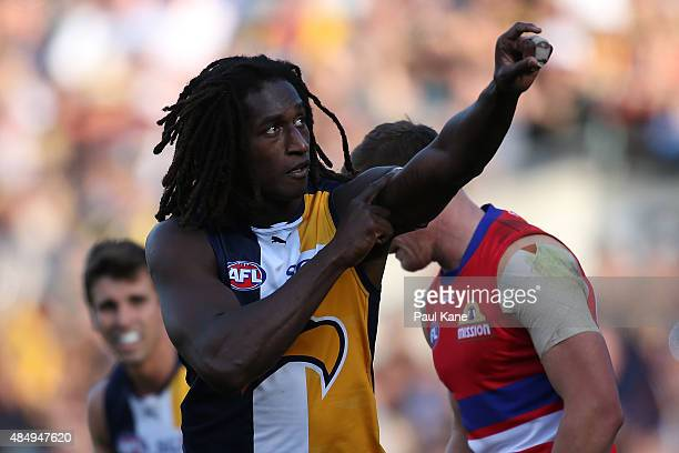 Nic Naitanui of the Eagles celebrates a goal and acknowledges his mother who recently passed away during the round 21 AFL match between the West...