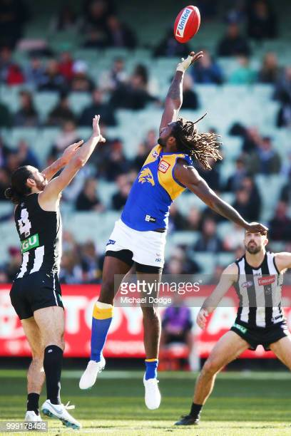 Nic Naitanui of the Eagles competes for the ball against Brodie Grundy of the Magpies during the round 17 AFL match between the Collingwood Magpies...
