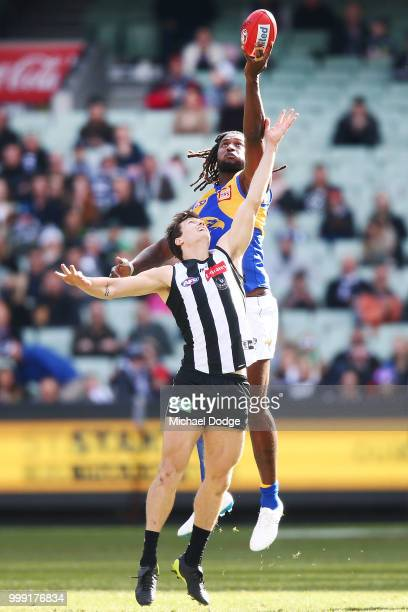 Nic Naitanui of the Eagles competes for the ball over Brody Mihocek of the Magpies during the round 17 AFL match between the Collingwood Magpies and...
