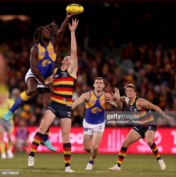 Nic Naitanui of the Eagles competes with Sam Jacobs of the Crows during the 2018 AFL round15 match between the Adelaide Crows and the West Coast...