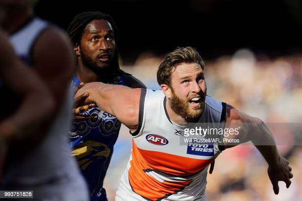 Nic Naitanui of the Eagles contests a ruck with Dawson Simpson of the Giants during the round 16 AFL match between the West Coast Eagles and the...