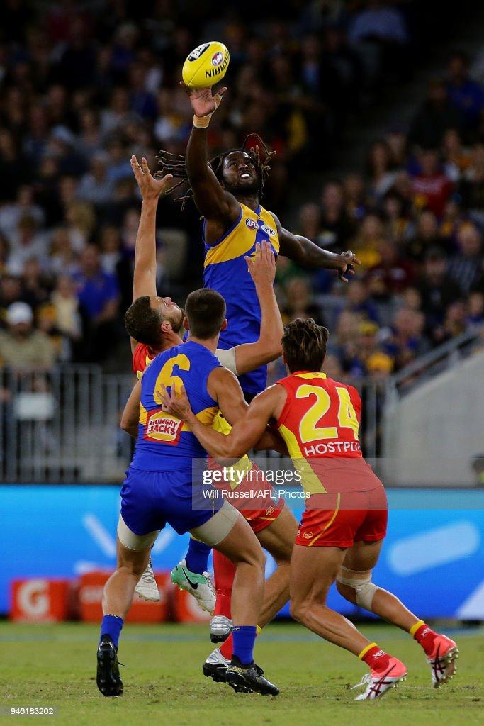 Nic Naitanui of the Eagles contests a ruck with Jarrod Witts of the Suns during the round four AFL match between the West Coast Eagles and the Gold Coast Suns at Optus Stadium on April 14, 2018 in Perth, Australia.
