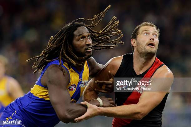 Nic Naitanui of the Eagles contests a ruck with Tom Bellchambers of the Bombers during the round 14 AFL match between the West Coast Eagles and the...