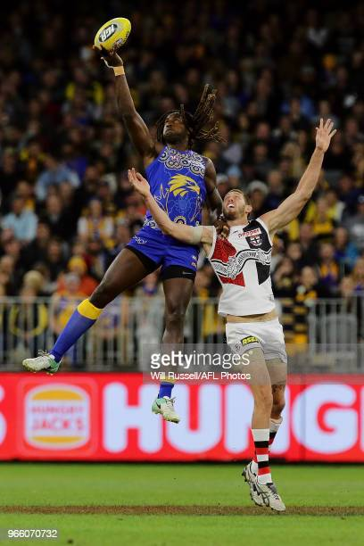 Nic Naitanui of the Eagles contests a ruck with Tom Hickey of the Saints during the round 11 AFL match between the West Coast Eagles and the St Kilda...
