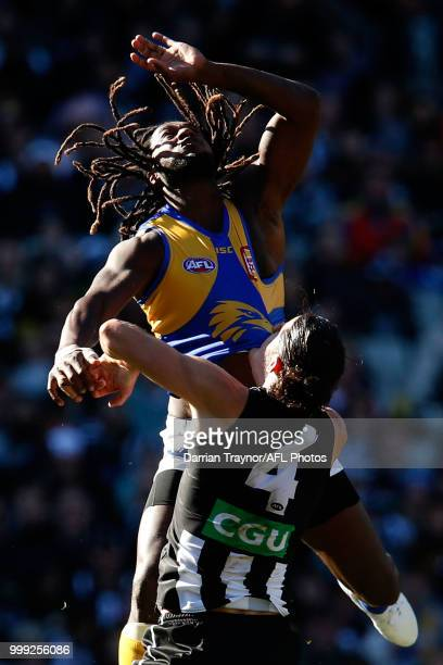 Nic Naitanui of the Eagles leaps over Brodie Grundy of the Magpies during the round 17 AFL match between the Collingwood Magpies and the West Coast...