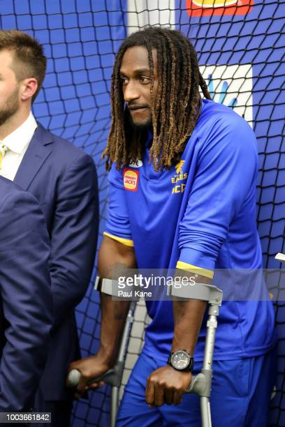 Nic Naitanui of the Eagles looks on after his team mates have sung the club songduring the round 18 AFL match between the West Coast Eagles and the...