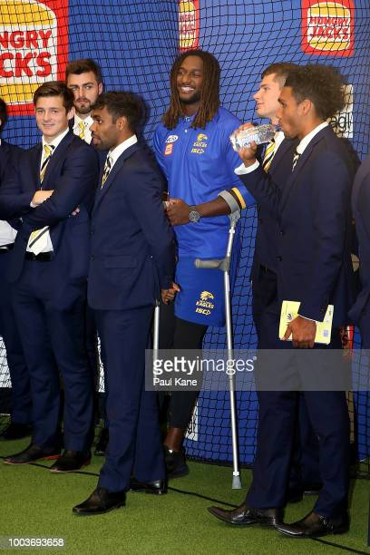 Nic Naitanui of the Eagles looks on after his team mates have sung the club song during the round 18 AFL match between the West Coast Eagles and the...