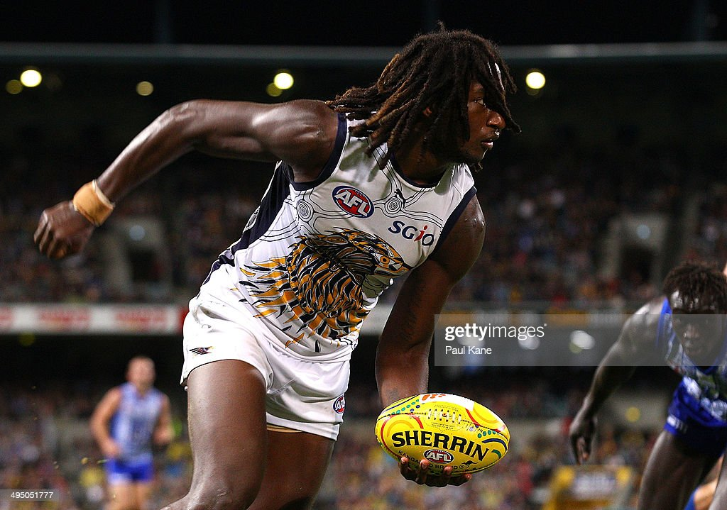Nic Naitanui of the Eagles looks to handball during the round 11 AFL match between the West Coast Eagles and the North Melbourne Kangaroos at Patersons Stadium on June 1, 2014 in Perth, Australia.