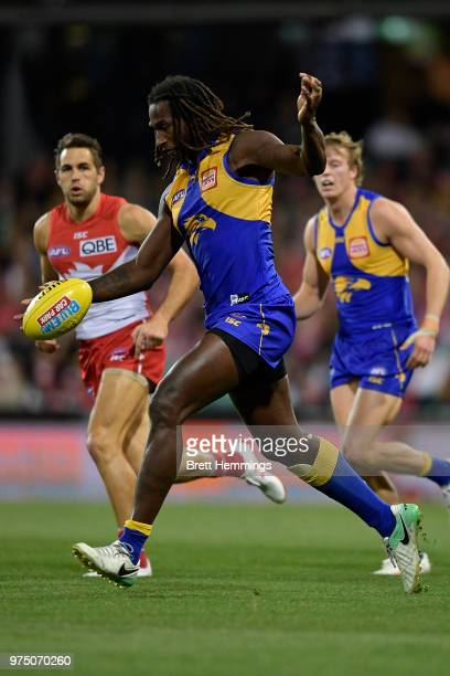 Nic Naitanui of the Eagles runs with the ball during the round 13 AFL match between the Sydney Swans and the West Coast Eagles at Sydney Cricket...