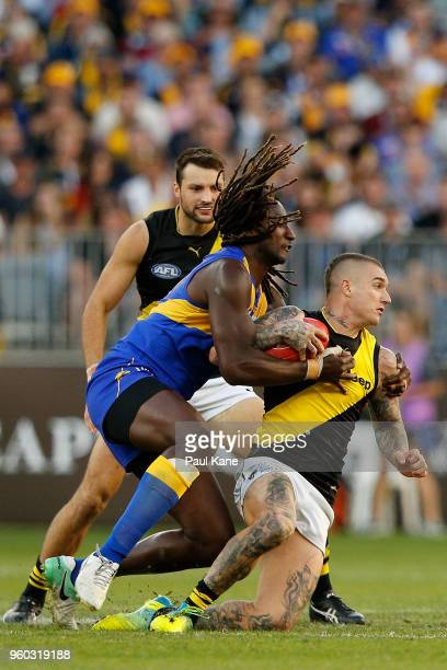 Nic Naitanui of the Eagles tackles Dustin Martin of the Tigers during the round nine AFL match between the West Coast Eagles and the Richmond Tigers...