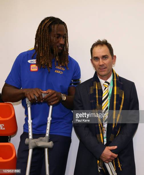 Nic Naitanui of the Eagles talks with Australian cricket head coach Justin Langer following the AFL Second Qualifying Final match between the West...