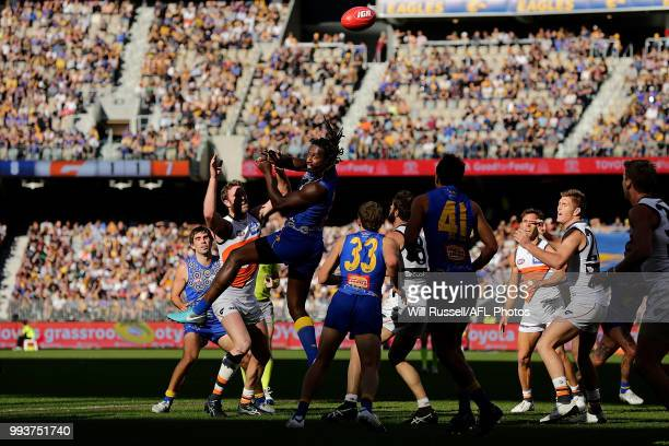 Nic Naitanui of the Eagles taps the ball during the round 16 AFL match between the West Coast Eagles and the Greater Western Sydney Giants at Optus...