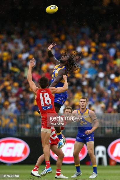 Nic Naitanui of the Eagles wins a ruck contest against Callum Sinclair of the Swans during the round one AFL match between the West Coast Eagles and...