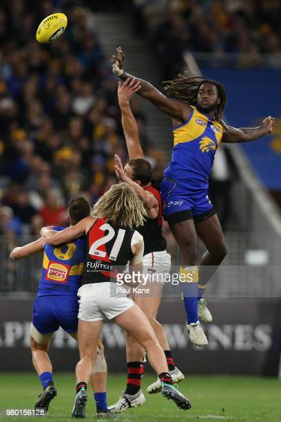 Nic Naitanui of the Eagles wins a ruck contest during the round 14 AFL match between the West Coast Eagles and the Essendon Bombers at Optus Stadium...