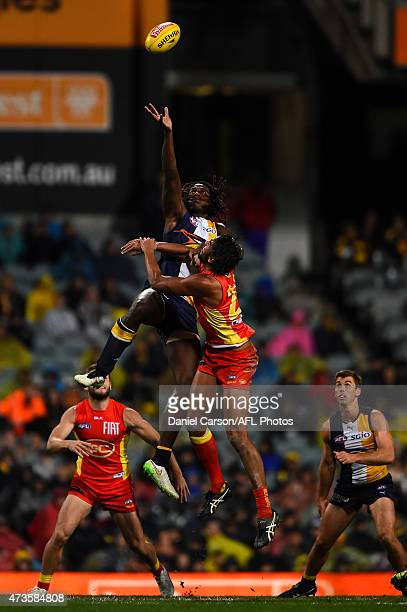 Nic Naitanui of the West Coast Eagles contests a ruck with Tom Nicholls of the Gold Coast Suns during the round seven AFL match between the West...