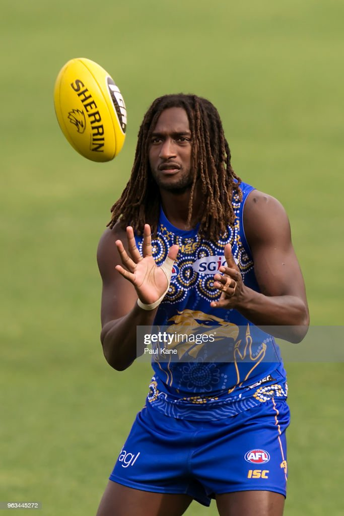 Nic Naitanui receives the ball during a West Coast Eagles AFL training session at Subiaco Oval on May 29, 2018 in Perth, Australia.