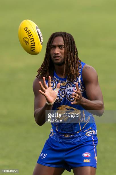 Nic Naitanui receives the ball during a West Coast Eagles AFL training session at Subiaco Oval on May 29 2018 in Perth Australia