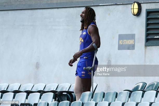 Nic Naitanui watches his team mates during a West Coast Eagles AFL training session at Subiaco Oval on September 10 2018 in Perth Australia