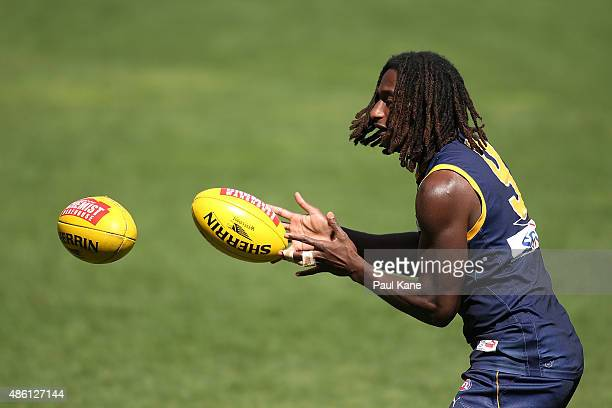 Nic Naitanui works on a handball drill during a West Coast Eagles AFL training session at Domain Stadium on September 1 2015 in Perth Australia