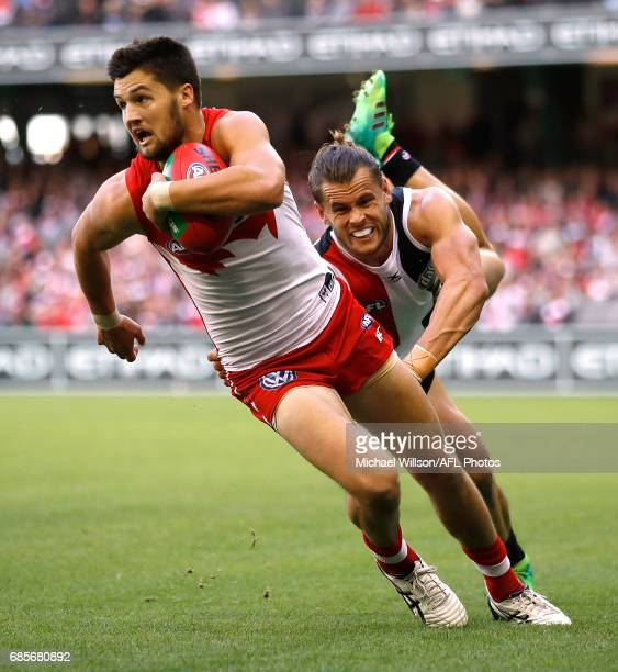 Nic Newman of the Swans is tackled by Maverick Weller of the Saints during the 2017 AFL round 09 match between the St Kilda Saints and the Sydney...