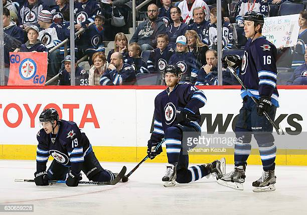 Nic Petan Joel Armia and Shawn Matthias of the Winnipeg Jets take part in the pregame warm up prior to NHL action against the Columbus Blue Jackets...