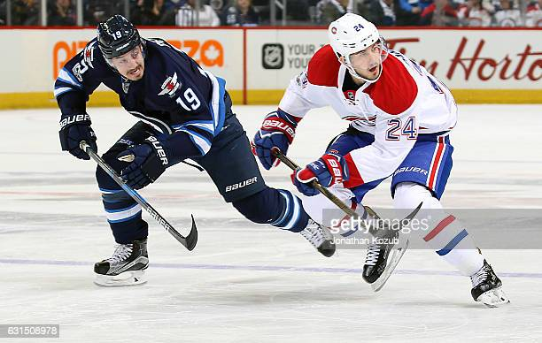 Nic Petan of the Winnipeg Jets and Phillip Danault of the Montreal Canadiens follow the play down the ice during first period action at the MTS...