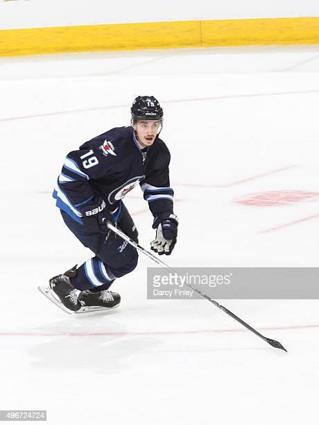Nic Petan of the Winnipeg Jets keeps an eye on the play during first period action against the Tampa Bay Lightning at the MTS Centre on October 23...
