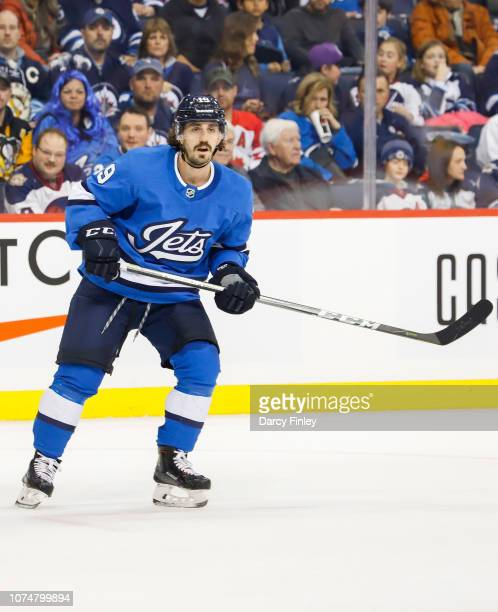 Nic Petan of the Winnipeg Jets keeps an eye on the play during second period action against the Pittsburgh Penguins at the Bell MTS Place on November...