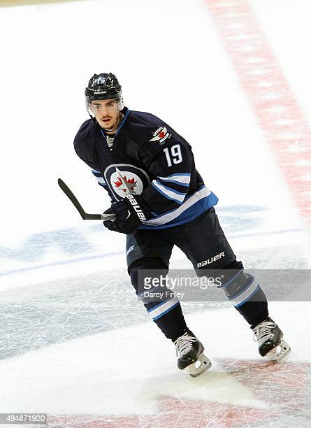 Nic Petan of the Winnipeg Jets keeps an eye on the play during second period action against the Minnesota Wild at the MTS Centre on October 25 2015...