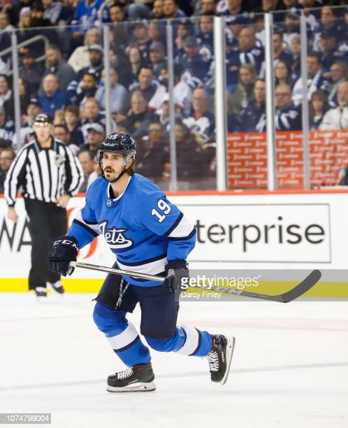 Nic Petan of the Winnipeg Jets keeps an eye on the play during third period action against the Pittsburgh Penguins at the Bell MTS Place on November...