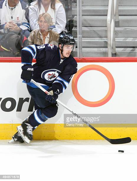 Nic Petan of the Winnipeg Jets plays the puck along the boards during first period action against the Minnesota Wild at the MTS Centre on October 25...