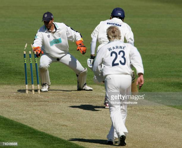 Nic Pothas of Hants runs out Michael Vaughan of Yorks during day one of the LV County Championship match between Hampshire and Yorkshire at The Rose...