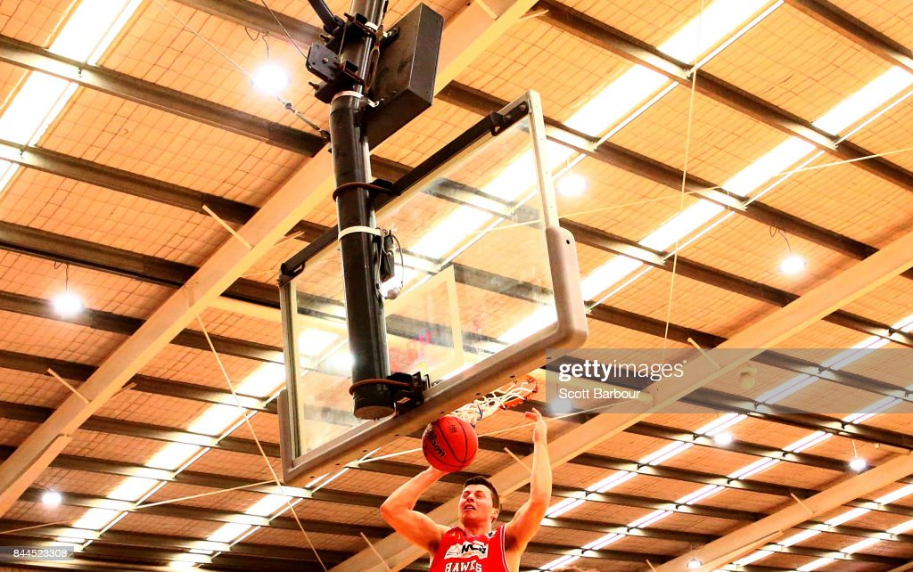 Nic Pozoglou of the Hawks dunks the ball during the 2017 NBL Blitz pre-season match between the Cairns Taipans and the Illawarra Hawks at Traralgon Basketball Centre on September 9, 2017 in Traralgon, Australia.