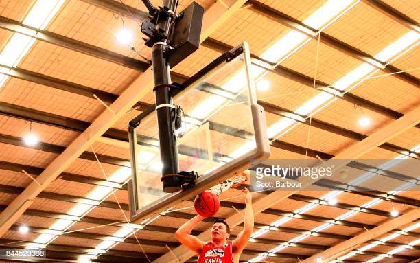 Nic Pozoglou of the Hawks dunks the ball during the 2017 NBL Blitz preseason match between the Cairns Taipans and the Illawarra Hawks at Traralgon...
