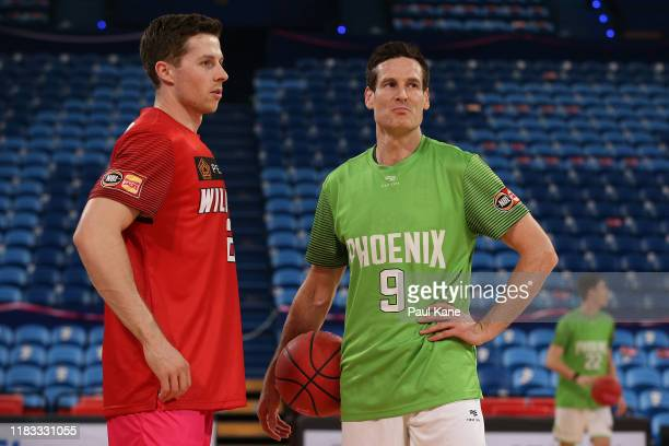 Nic Pozoglou of the Wildcats and Ben Madgen of the Phoenix share a moment while warming up during the round four NBL match between the Perth Wildcats...