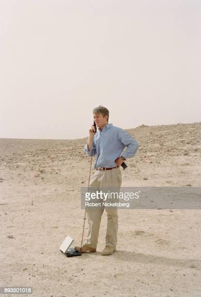 Nic Robertson a correspondent for CNN speaks on a Thrane Thrane 64k sat phone in an area bombed by US aircraft November 1 2001 in Chowkar Karez...