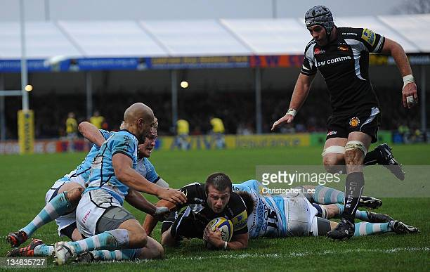 Nic Sestaret of Exeter is tackled by Errie Claassens of Worcester just short of the try line during the AVIVA Premiership match between match between...