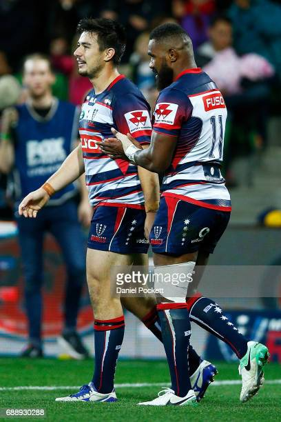 Nic Stirzaker of the Rebels celebrates wih Marika Koroibete of the Rebels after a try during the round 14 Super Rugby match between the Rebels and...