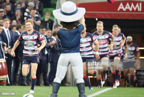 Nic Stirzaker of the Rebels leads his side onto the field during the round eight Super Rugby match between the Rebels and the Brumbies at AAMI Park...