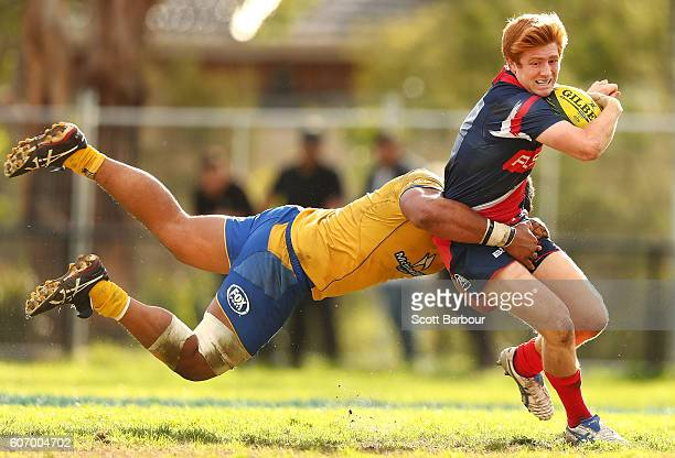 Nic Stirzaker of the Rising is tackled by Criff Tupou of City during the round four NRC match between Melbourne Rising and Brisbane City at...