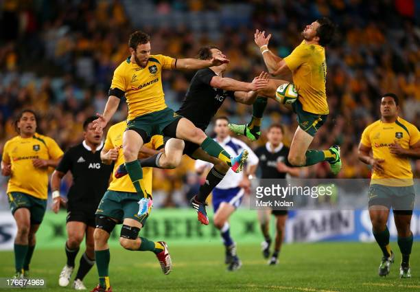 Nic White and Adam Ashley Cooper of the Wallabies and Ben Smith of the All Blacks contest a high ball during The Rugby Championship Bledisloe Cup...