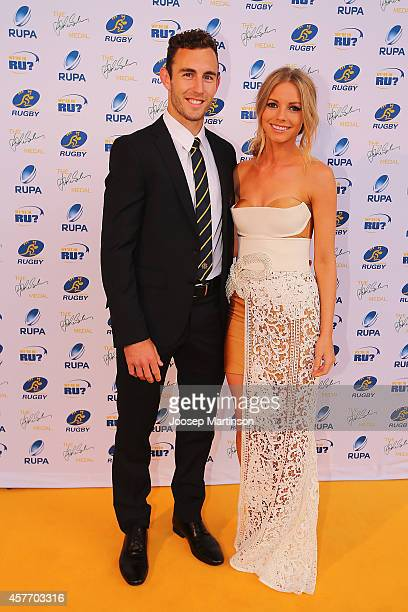 Nic White and Melissa Gibb arrive ahead of the 2014 John Eales Medal at Royal Randwick Racecourse on October 23 2014 in Sydney Australia