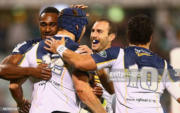 Nic White and other Brumbies team mates celebrate a try by Pat McCabe during the round eight Super Rugby match between the Brumbies and the Bulls at...