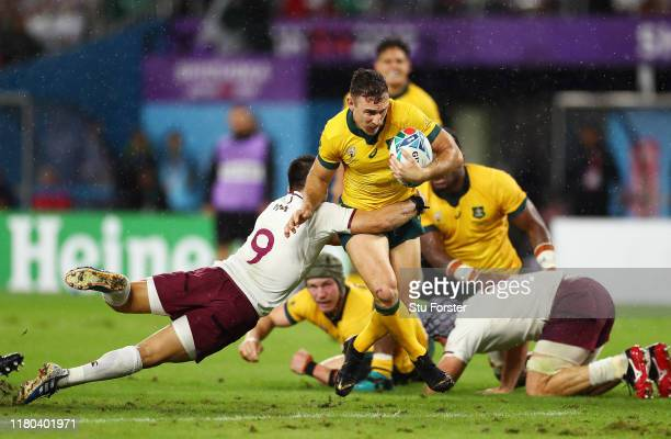 Nic White of Australia is tackled by Gela Aprasidze of Georgia during the Rugby World Cup 2019 Group D game between Australia and Georgia at Shizuoka...