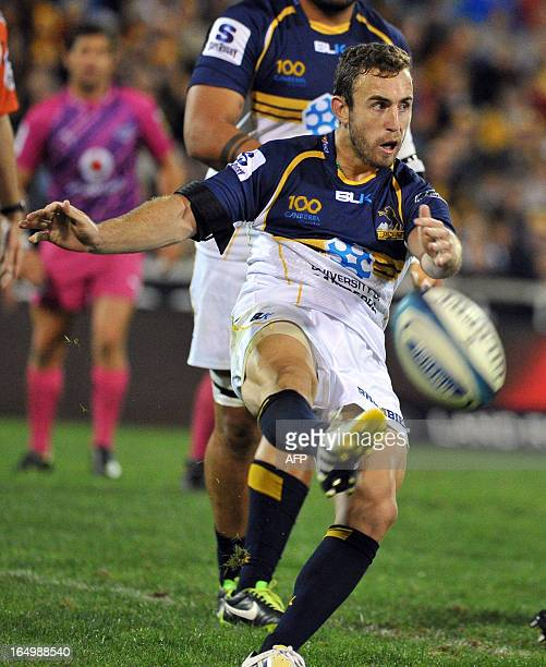 Nic White of the Brumbies kicks the ball against the Bulls during round 7 of the rugby Super 15 match in Canberra on March 30 2013 The Brumbies won...