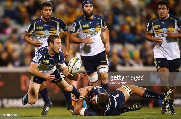 Nic White of the Brumbies looks for support during the round 16 Super Rugby match between the Brumbies and the Rebels at Canberra Stadium on May 31...