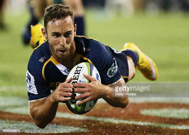 Nic White of the Brumbies scores a try during the round one Super Rugby match between the Brumbies and the Reds at GIO Stadium on February 13 2015 in...