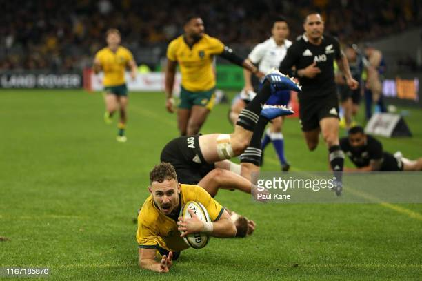 Nic White of the Wallabies crosses for a try during the 2019 Rugby Championship Test Match between the Australian Wallabies and the New Zealand All...